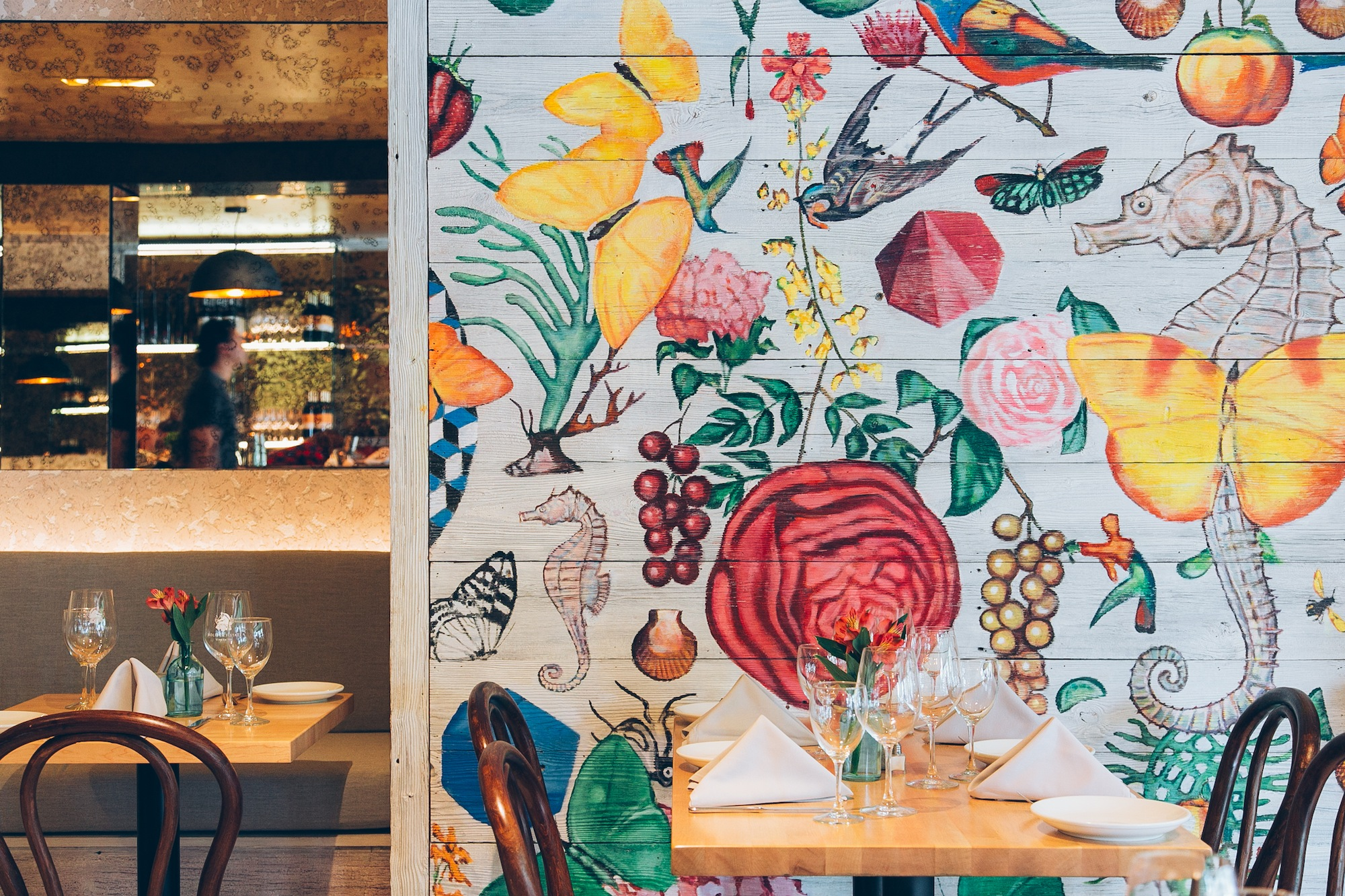 A mural inside Wölffer Kitchen helps to give the restaurant a bohemian vibe. image: conor harrigan